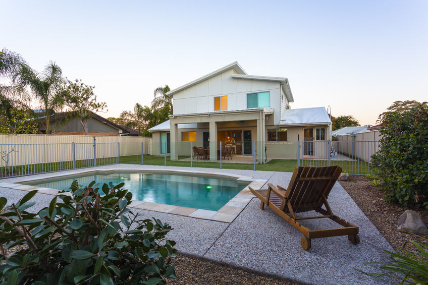 36454966 – modern home exterior with pool at dusk